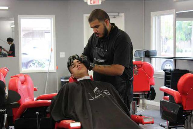 Anthony Parga of Caddys gives a cut