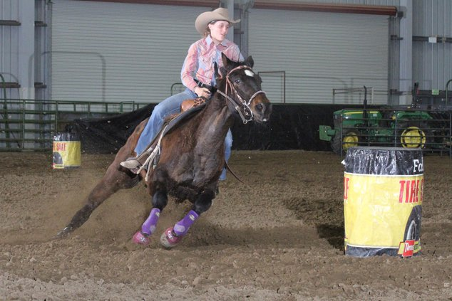 Mallory Coit races around a barrel