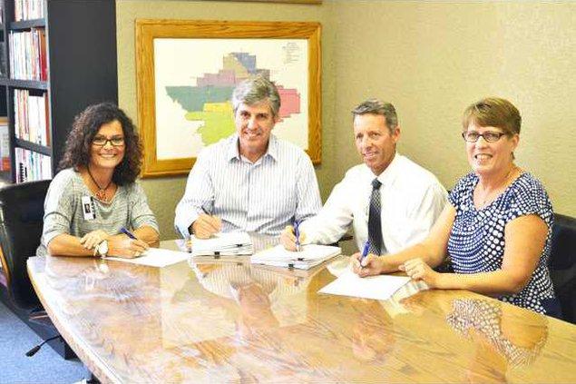 TUSD bond signing 2