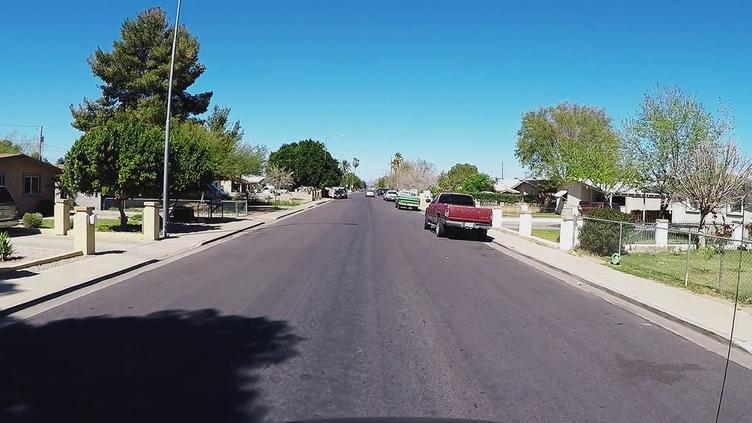 videoblocks-driving-viewpoint-residential-neighborhood-street-mesa-arizona_bxunkg-cg_thumbnail-full01.png
