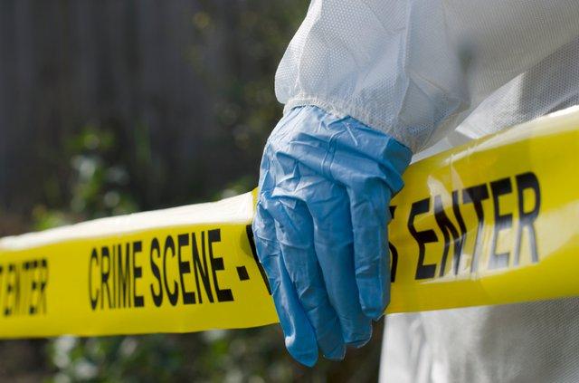 Crime-Scene-investigation_hand-on-tape.jpg