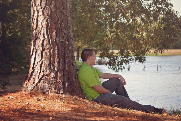 sitting by tree