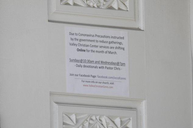 Covid sign on door