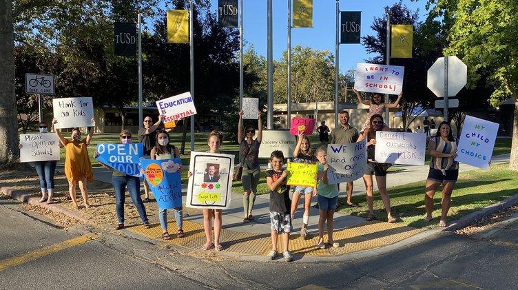 reopen schools protest