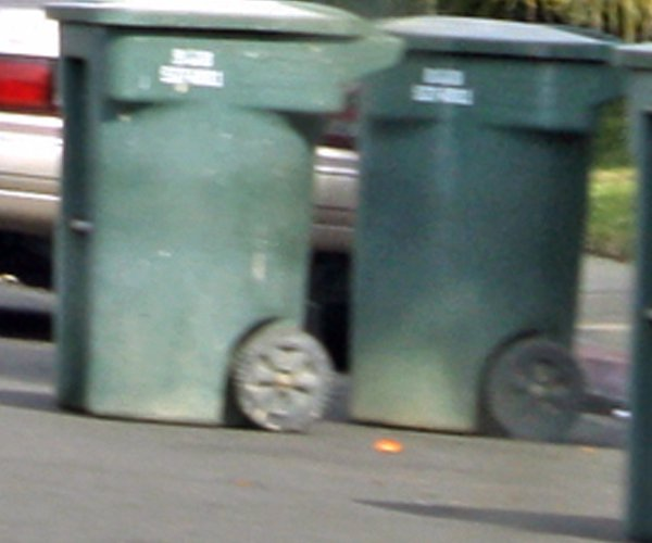 Garbage cans lined up