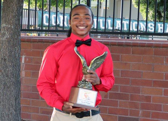 Isaiah Hidalgo with trophy