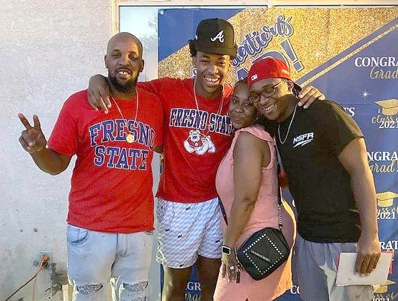Phoenix Jackson with parents